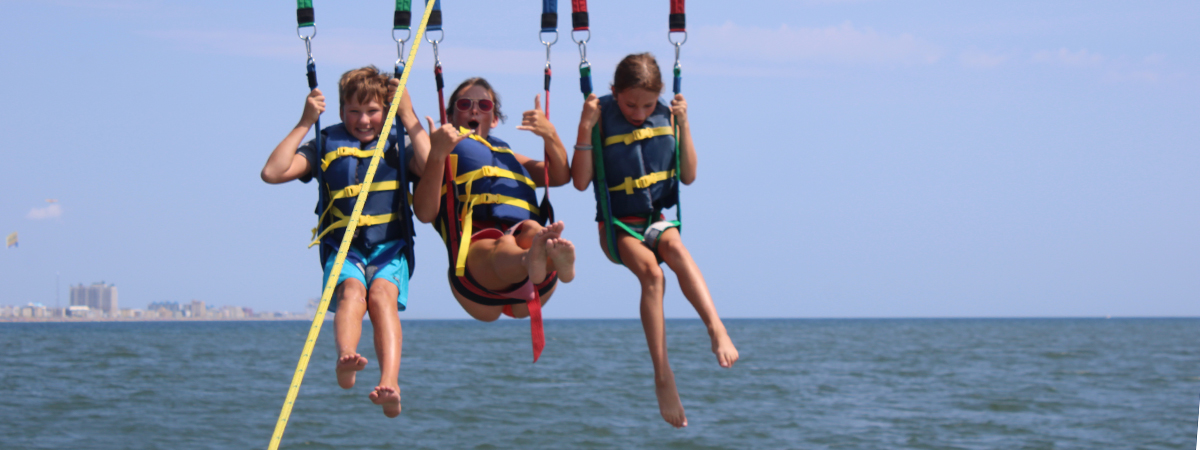 Sea Rocket Adventures offers parasailing and banana boat rides from The Bay Resort Waterfront Hotel in Dewey Beach, Delaware